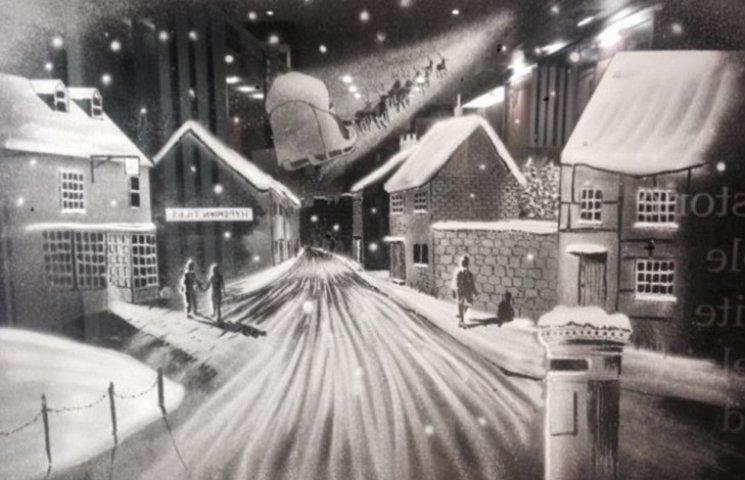 Як художник створює шедеври на шибках за допомогою снігу та пензля