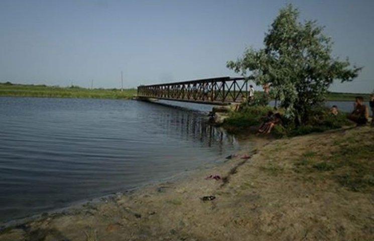 На Миколаївщині дві дівчинки, що грали біля моста, впали в річку: одна загинула
