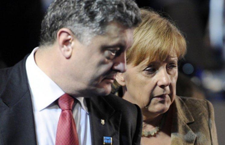 Меркель с Порошенко признали, что мир на Донбассе под угрозой срыва